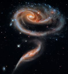 Exploring Universe: In celebration of the 21st anniversary of the Hubble Space Telescope's deployment into space, astronomers at the Space Telescope Science Institute in Baltimore, Md., pointed Hubble's eye to an especially photogenic group of interacting galaxies called Arp 273. (Rose Galaxy)