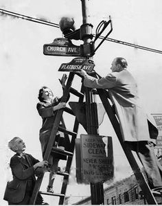 Hanging a Brooklyn street sign- I grew up around flatbush! very cool photo! interesting to see the original sign being put up back then :) - liza