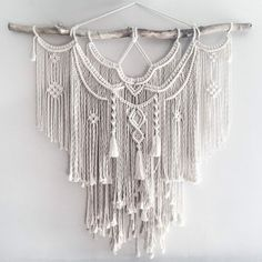 Large Macrame Wall hanging  A fusion knots and of course lots of fringing! The star of this piece is a beautiful long branch.  Your piece is made by hand using natural unbleached cotton and revived branches from local woods in Upstate NY and the Adirondacks. ✨✨✨  SIZING She measures roughly 44in x 45in (including the branch) so she is sure to stand out wherever you choose to hang her.  Sizing is approximate: Branch Width - 44 Macrame Length - 38 Rope hanger- 10  ✨✨✨  MADE TO ORDER  I will…