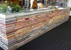 Recycled books, carpet tiles or other blocky objects can be turned into reception desks, layout tables and all sorts with a bit of clever fixing, cladding and a nice top.