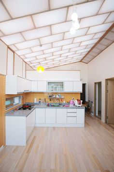 Low Cost Housing by JYA Architects uses layers of plastic bubble wrap for a translucent roof.