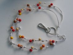 Avainnauha #13 by Miss Piggy / Key chain, ID holder. Made with wooden beads and waxed cord.
