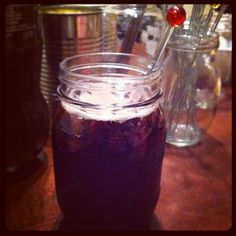 """Hipster Sangria!  Looking for something new to drink tonight? try hipster sangria AKA the Spanish """"Calimocho"""". It's a mix of coca cola and inexpensive red wine over ice.     I served it in mason jars with ice cans and other jars to fit the theme. check it out! It was fun, tweet @stuatlcanton and let me know if you like or dislike"""