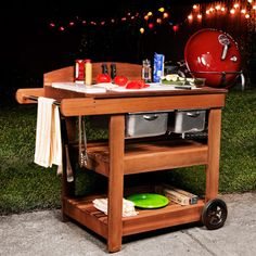 Wood Summer Cookout Cart DIY - What a great cedar cart complete with removeable cutting board with a scrap dump and a storage drawer, a backsplash and a towel rack!