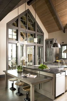 A dramatic window wall is the highlight of this kitchen featuring an island with a sink on each end & stainless steel in abundance. An amazing space...V