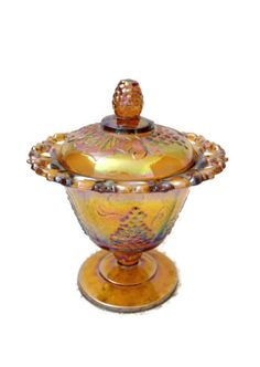 Beautiful vintage carnival glass candy dish by Indiana Glass Company. The pattern on this candy dish is called Harvest, and the color is gold carnival.