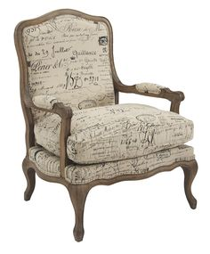 Fåtölj med fransk text i skrivstil på linnetyg 40% och bomull 60%. Trästommen är av ek. Vacker fåtölj som även kan kompletteras med fotpall artikelnummer