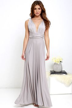 """No matter how you choose to style it, the All the Sway Convertible Light Grey Maxi Dress will bring all the compliments your way! Two, 75"""" long lengths of jersey knit fabric rise from an elastic waistband, and wrap into a multitude of stylish bodice styles! Maxi skirt ends at a raw hemline. Want Styling Tips? <a href='http://bit.ly/HowToWearIt' target='_blank'>See How To Wear It!</a>"""