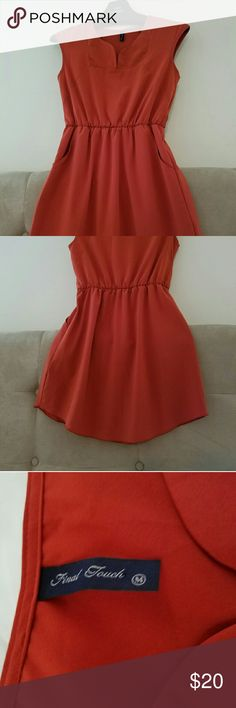 Rustic Orange dress Day to night dress has pockets and is a size Medium. Only worn a few times. Did not come with a belt. Dresses Midi