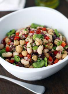 Mediterranean Bean Salad | Fava beans, cannellini beans, chickpeas, olives, red pepper, onion, parsley, garlic, oil, vinegar, sugar, spices.