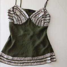 Bebe khaki blouse stunning! Dark khaki Bebe top with silver sequences 100% silk. Beautiful stunning sexy. bebe Tops