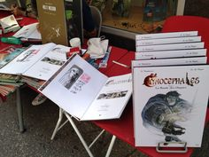 """Signing copies of """"Cynocephaleks- La bande des dogues"""" edited in France, Belgium and Switzerland by EP Editions/ GroupePaquet. """"Apostrophes"""" Comic bookshop in Neuchatel"""
