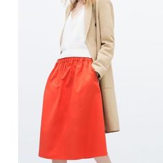 NWOT   Zara Elastic Waist Skirt, Orange, Large NWOT, worn once to try on. Straight cut, mid-length full skirt, with adorable pockets! Very comfortable material. Size large, No snags, stains, or pilling.  Fantastic color! Zara Skirts Midi