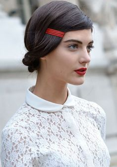 Use a group of colored bobby pins (flat side up) instead of a barrette.