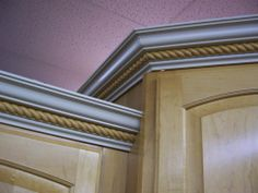 Crown moulding gives and elegant touch that can be creative and add texture