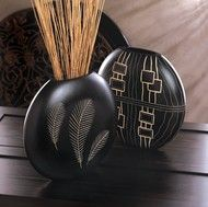 """A stunning piece of art for your mantel! This tribal-inspired black decorative vase is etched with three stylized feathers that let the natural color shine through. Item weight: 2.20lbs Item dimensions: 4.00"""" W x 11.00"""" H x 13.00"""" L"""