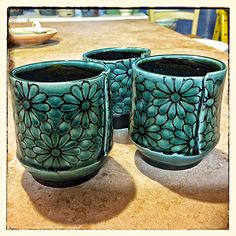 New cups with an underglaze pattern - still hot from the kiln.