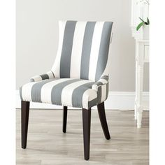 Enjoy the modern flexibility of this gray dining chair. Featuring gray and beige stripes made of polyester and linen-blended upholstery, this wooden dining chair is attractive and comfortable. A solid