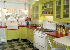 I LIKE THE RED COUNTERTOP> We love this fun, retro modern look! Get something similar with custom-painted cabinets, Silestone Stellar Fire or Caesarstone Ruby Reflections quartz counters, and a Marmoleum checkerboard floor. Kitchen Benchtops, Kitchen Countertops, Kitchen Cabinets, Glass Cabinets, Green Cabinets, Kitchen Island, Old Kitchen, Vintage Kitchen, Kitchen Decor