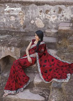 Wonderful floral printed lace looks beautiful on this red & black georgette saree.