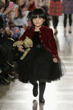 Angela Wang walks the runway at the Ralph Lauren Fall 14 Children's Fashion Show in Support of Literacy at New York Public Library on May 19, 2014 in New York City.