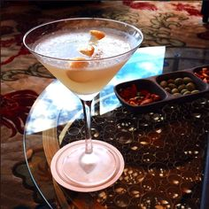 Royal Tea martini (Mandarin Bar Las Vegas) Absolut Mandarin vodka, homemade simple syrup,  chilled Osmanthus Oolong tea and fresh lemon  juice.