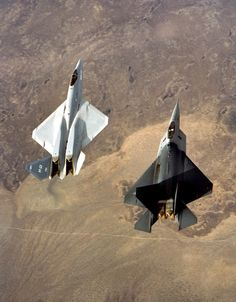 YF-23 left and YF-22 right, they were both flight testing when I worked Line-D at Edwards AFB.