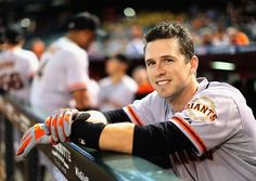 PHOENIX, AZ - SEPTEMBER 17: Buster Posey #28 of the San Francisco Giants watches from the dugout during the MLB game against the Arizona Diamondbacks at Chase Field on September 17, 2014 in Phoenix, Arizona. (Photo by Christian Petersen/Getty Images)