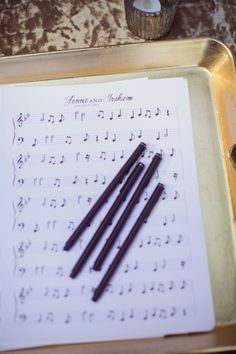 Use blank music sheets, with no notes!    guestbook on music sheets // photo by Brandon Kidd