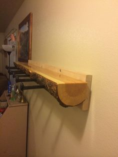 Log coat rack with railroad spike hangers. #LogFurniture