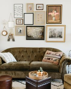 A gallery wall, upholstered sofa, and mix of patterns give this living room a down-to-earth luxury!