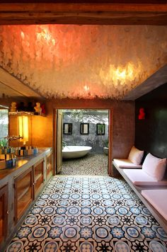 The only words to describe this Indonesian bathroom with capiz ceiling are simply beautiful.