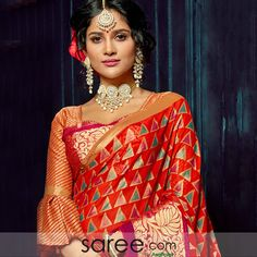 This red chiffon brasso saree is a treat for the ones who prefer ethnicity with a modern touch. Colorful contemporary forms adorn the red chiffon saree while a flower vine panel o the border imparts a traditional touch. Red Chiffon, Chiffon Saree, Saree Blouse Designs, Blouse Patterns, Lehenga Choli Online, Fashion Sketchbook, Exclusive Collection, Sari, Blouses