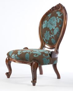 Cameo Grandmother Armchair. An open armed Victorian chair with flora carvings and Rococo influences. The Cameo enjoyed its hey day in the 1850s. Available painted or polished in any colour and upholstered in any fabric.