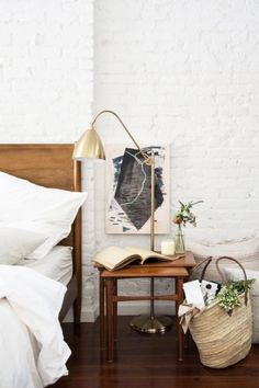 Modern bedroom with white brick walls and mid-century bed via @thouswellblog