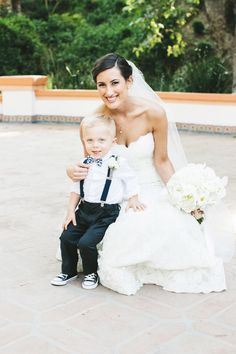 Love this ring bearer outfit! Suspenders + Chucks + Bowtie I like how this ring bearer is dressed and i want a pic like this with David and Mikey Wedding Attire, Wedding Dresses, Ring Bearer Outfit, Ring Bearer Suspenders, Page Boy, Wedding Bells, Boutonnieres, Getting Married, Rose