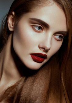 Bold brows and red lips.
