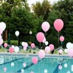 Balloons tied to weights in the pool.