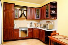 Small #Kitchen of the Day: Cherry-stained cabinets.