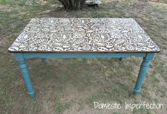 Amazingly cute paisley table... Get yourself an old plain table and follow her directions... Use your stencil with the color you'd like, minwax over it... And do the legs. Done. :)