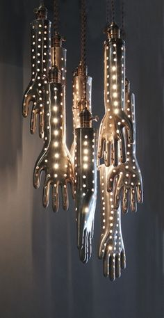 Handelier, A Chandelier Made With Vintage Aluminum Glove Molds