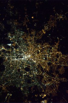 Berlin at night, 23 years after the Fall of the Berlin Wall. The divide is still visible from space due to different types of lightbulbs.