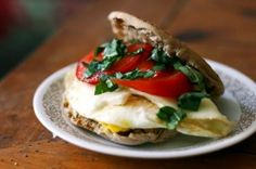 Caprese: Top a fried egg with fresh mozzerella cheese, sliced tomato, and fresh chopped basil. plus other healthyy breakfast sandwitches!