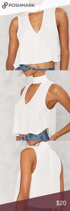 Nasty Gal Mock neck crop top Barely sheer white crepe fabric with choker detail, cutout front, plunging neckline and enclosed zipper at back. Runs true to size! Worn once, absolute pristine condition. Sold through nasty gal and is by the brand Cotton Candy LA. Super cute and on trend! Nasty Gal Tops Crop Tops