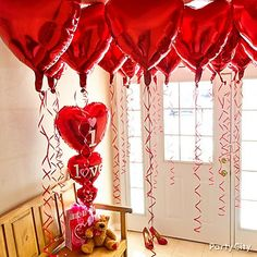 Greet her with a canopy of balloons as she walks in the door! Click the pic for more sweet Valentine's Day ideas to set her heart afloat!
