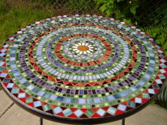 This was my first big mosaic project - a patio table. Some setbacks, but overall, a success.
