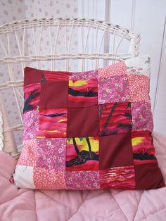 """Tropical Sunset"" Handmade toss cushion made from recycled clothing and bed linens. Even the stuffing is made from strips of recycled clothing. Pinks and reds 14 1/2"" x 14 1/2"""