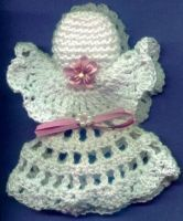 Small Angel using #10 crochet thread.  Would make a nice pin to wear or an ornament for tree.