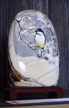 This stone came with it's own stand and I painted a tiny chickadee in snow on it. SOLD