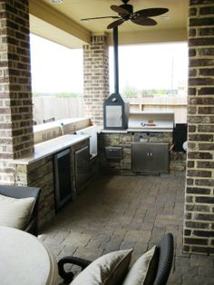 Paver patio with patio cover and an outdoor kitchen. Kitchen is complete with smoker, grill, crab boil burner, and much more in the Sugar Land, Texas area.
